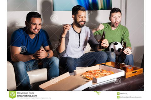 Friends Enjoying A Soccer Game On Tv Stock Photo - Image ...
