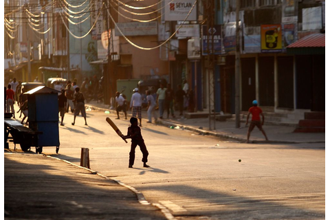 ROAD TO FREEDOM: Sri Lankan boys play a game of cricket on ...