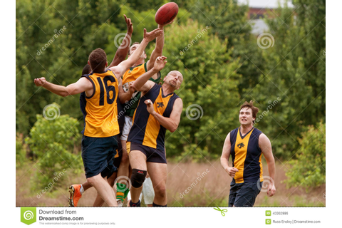Players Jump To Catch Ball In Australian Rules Football ...