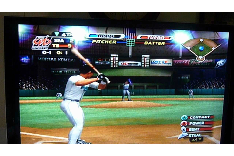 My son, having fun with MLB Slugfest 2003 on the Gamecube ...