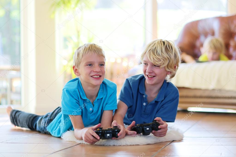Two brothers playing video games at home — Stock Photo ...