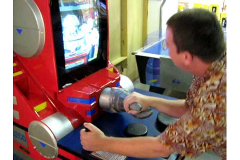 Challenging an arm wrestling video game in Universal ...