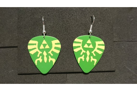 video game crest inspired guitar pick by TheCheekyGeekSmith