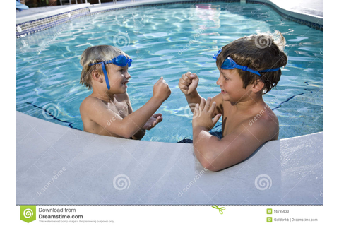 Boys Playing Games At Edge Of Swimming Pool Stock Image ...