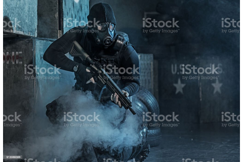 Gas Mask Wearing Lone Soldier In Smoky Indoor Urban ...