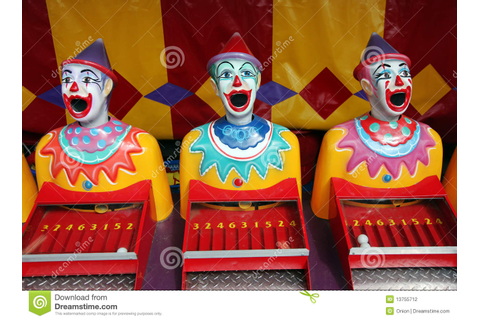 Row of carnival clowns stock photo. Image of game ...