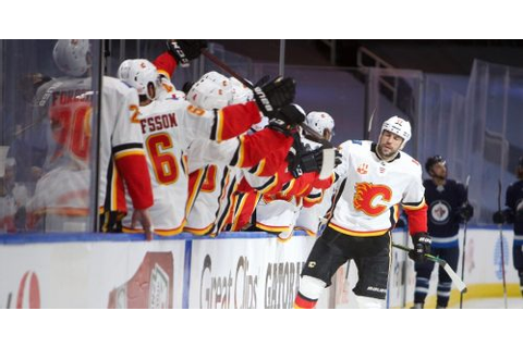 Six-goal outburst lifts the Calgary Flames past Jets in ...