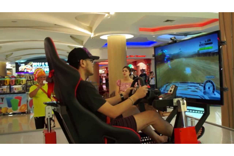playing a racing game in 4D playseat (moving chair) .4D ...