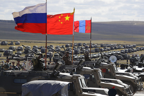 Putin's war games send signal to West, but Russia-China ...