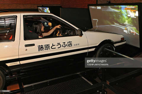 "A visitor enjoys the ""Initial D arcade stage 4 limited ..."