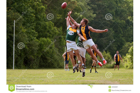 Players Jump For Ball In Australian Rules Football Game ...