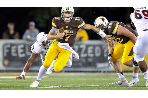 Inside the game: Wyoming QB Josh Allen naked and famous