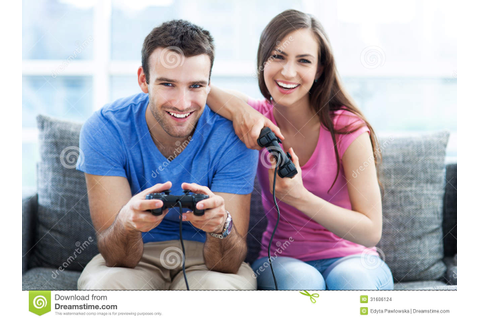 Couple playing video games stock photo. Image of casual ...